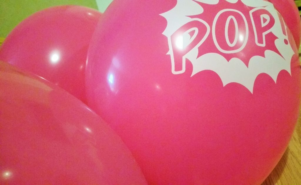budget party pink balloons pop