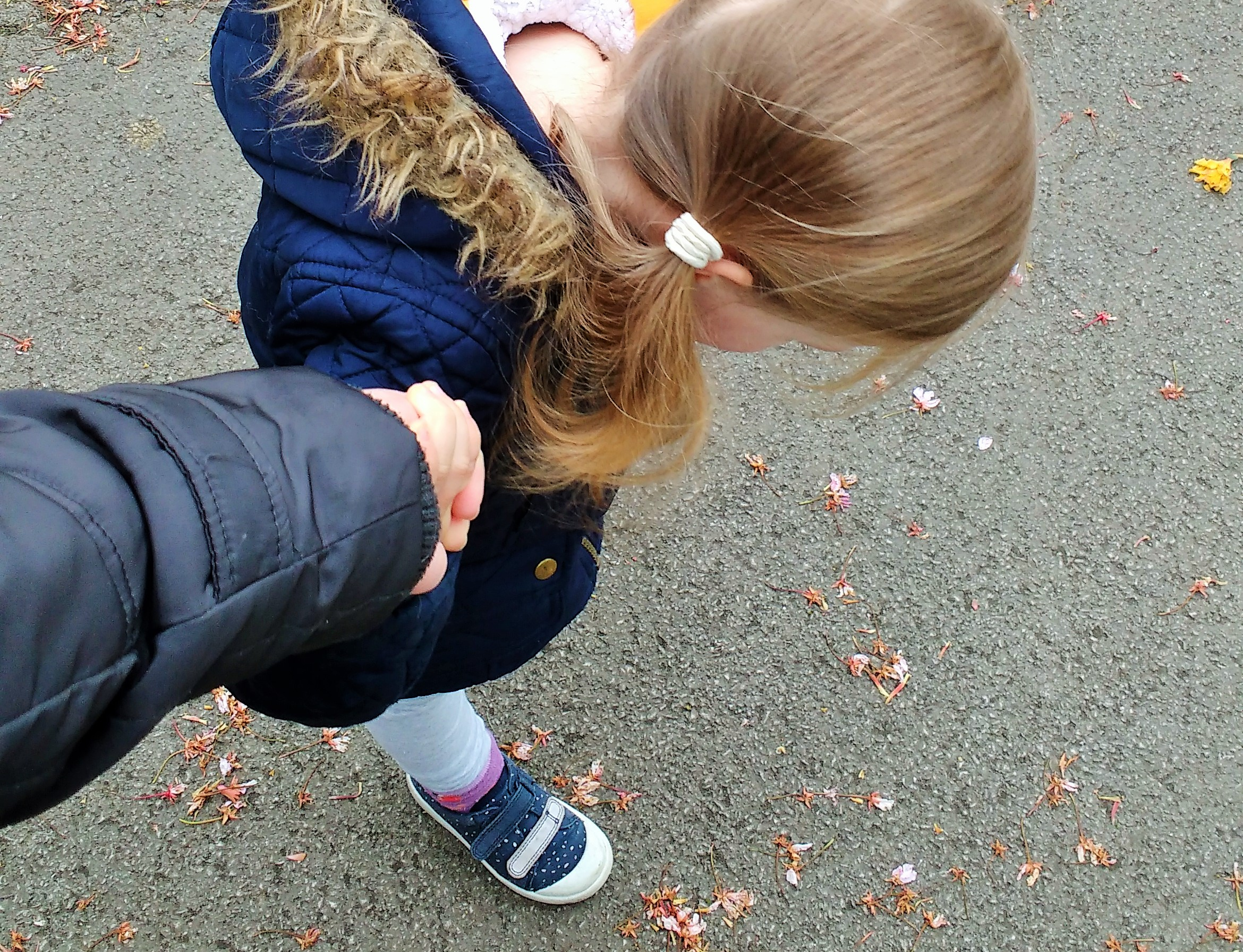 anxiety - child holding mother's hand, looking at the floor