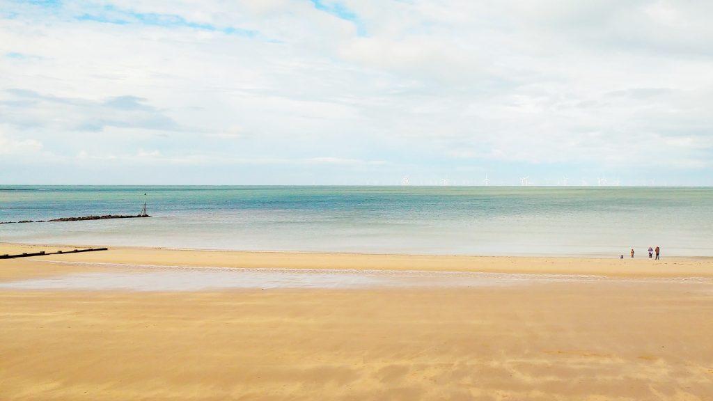 Middle class fraud blue sea and sandy beach