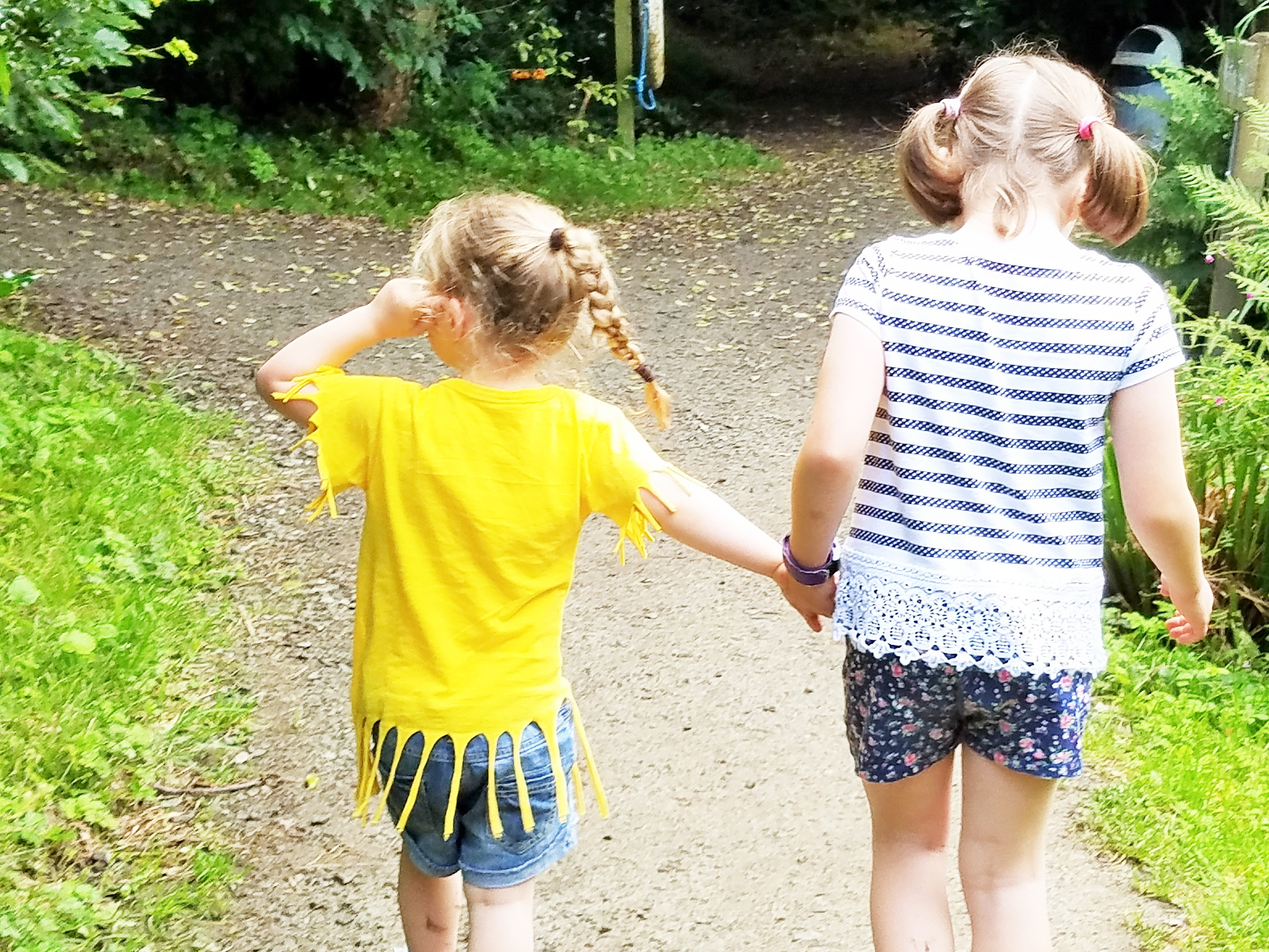 Sensitive big sister and little sister holding hands - how to parent a child who is afraid of the dark