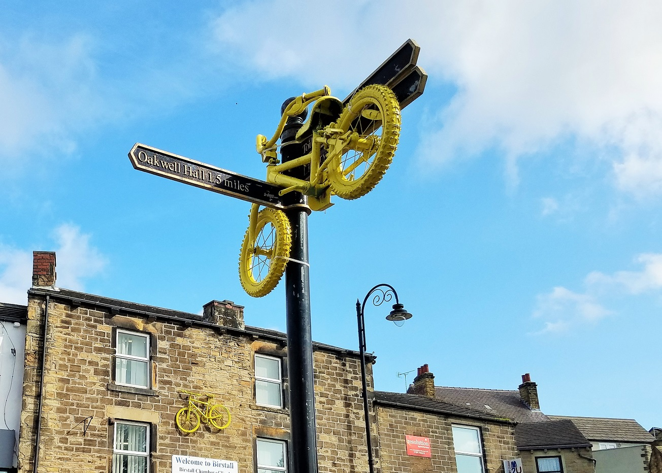 VTech trike yellow bikes in birstall sign post for oakwell hall