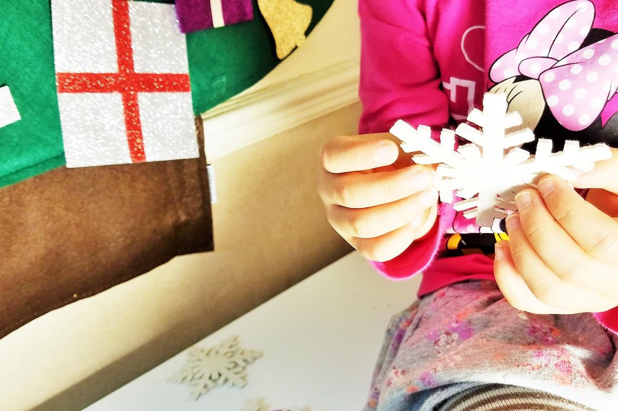 Felt Christmas Decorations Child holding snowflake decoration