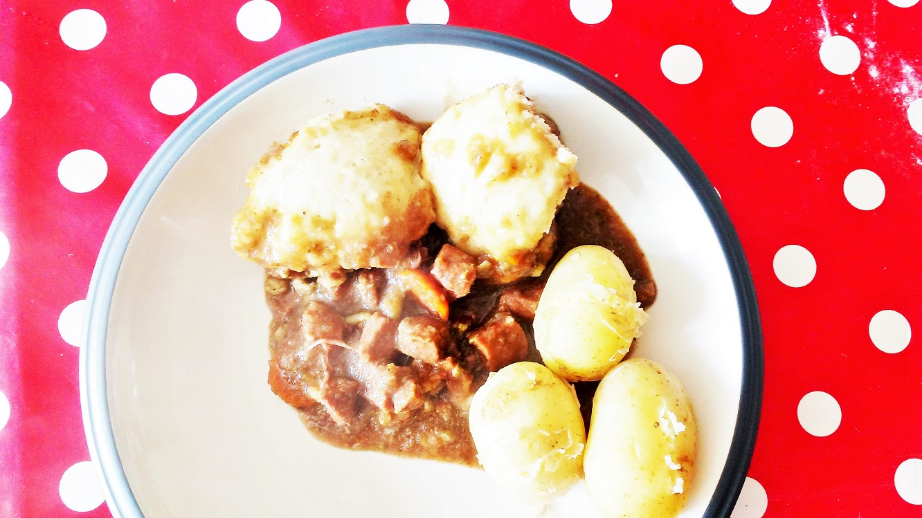 Stew and dumplings served on a plate