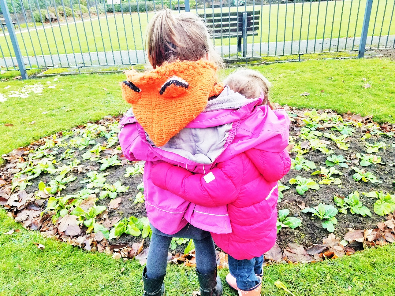 Childhood anxiety - sisters embrace in the park Blogcrush week 49