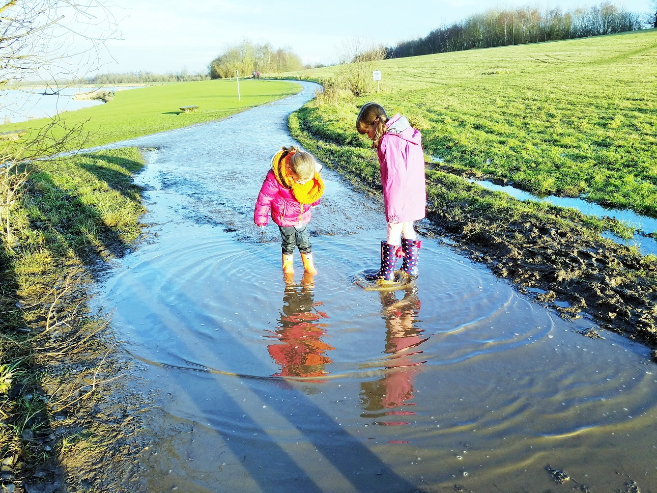 average child - children splashing in puddles together