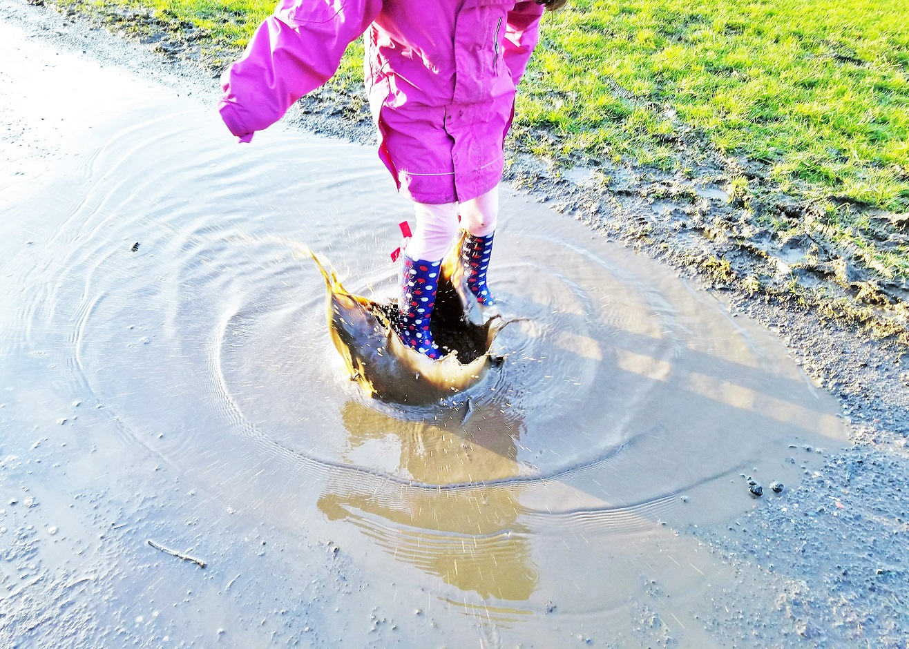 To my average child who seems invisible - child splashing in puddles - Happy mum