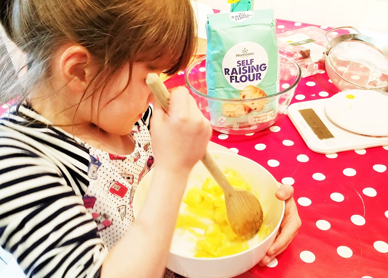 average child - child baking, stirring mixing bowl