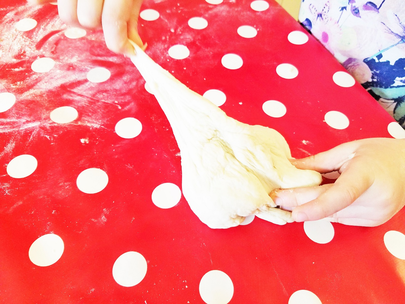 How A Bread Maker Made Baking With this Kids Fun Again - child pulling at bread dough