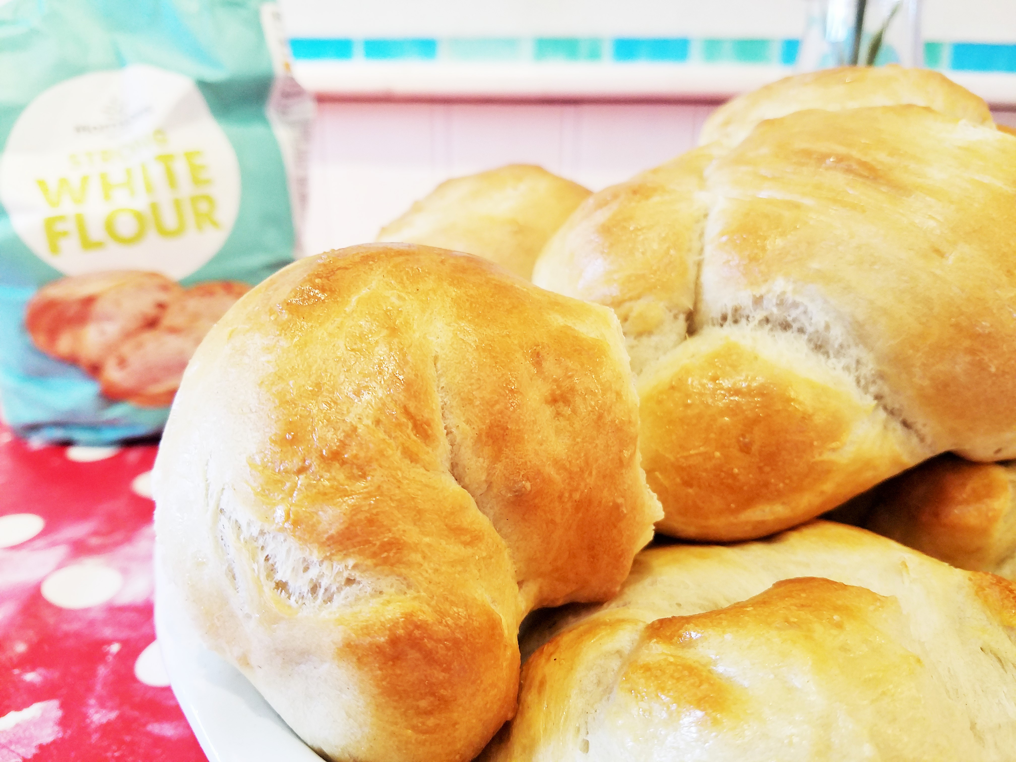 Bread maker bread rolls with strong white bread flour in the background