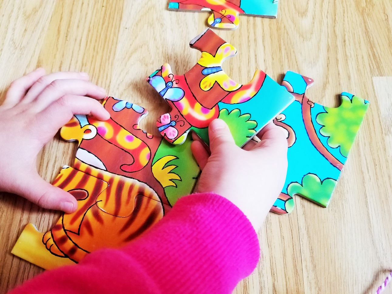 Things my kids say that make my heart sing - I've got an idea - child doing an animal jigsaw