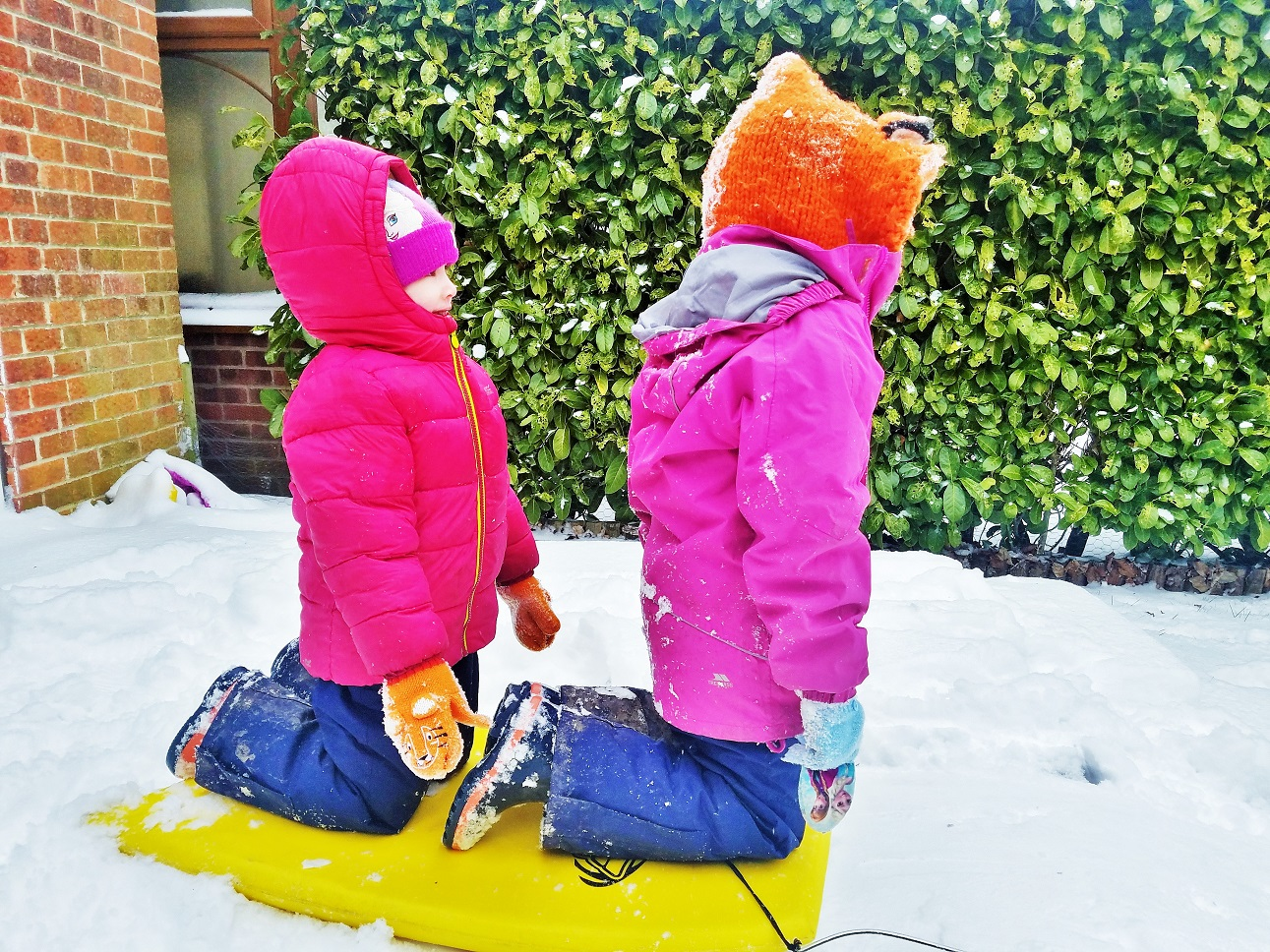 9 things my kids say that make my heart sing - that was brilliant - children riding a sledge sisters