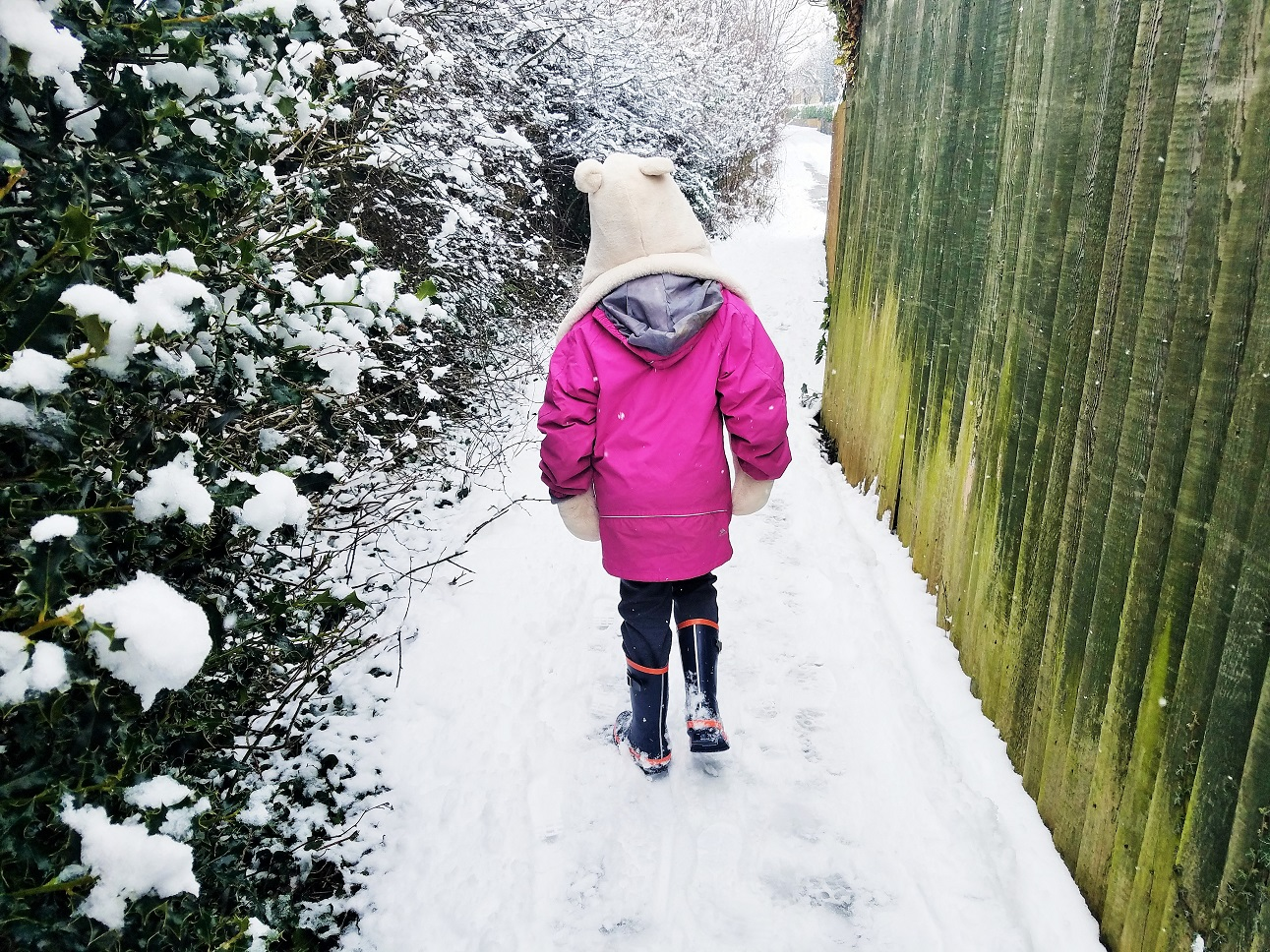 live away from home - solitary child walking through snow
