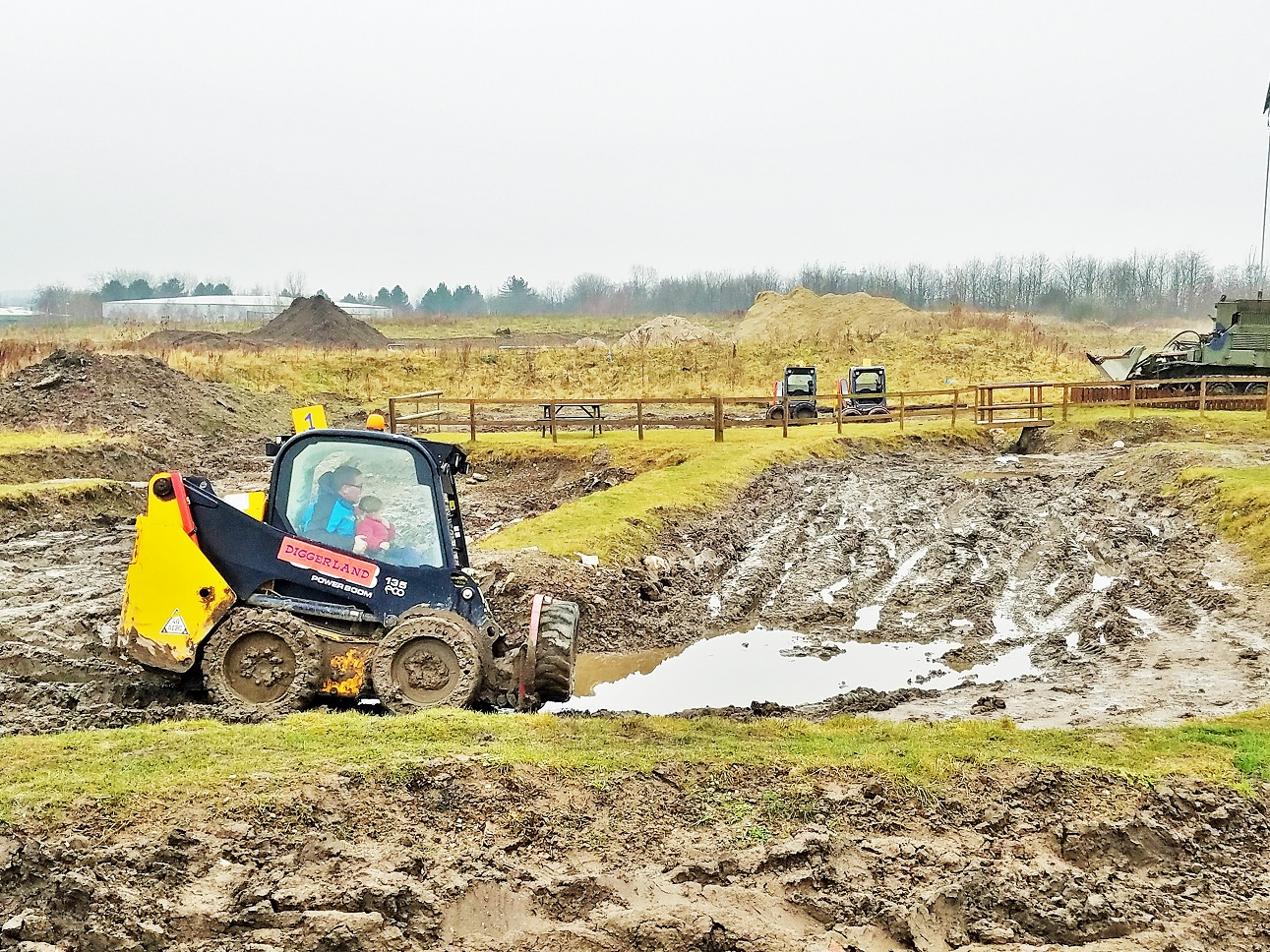 Diggerland in the rain - digger driving through big muddy puddles - kids' party ideas