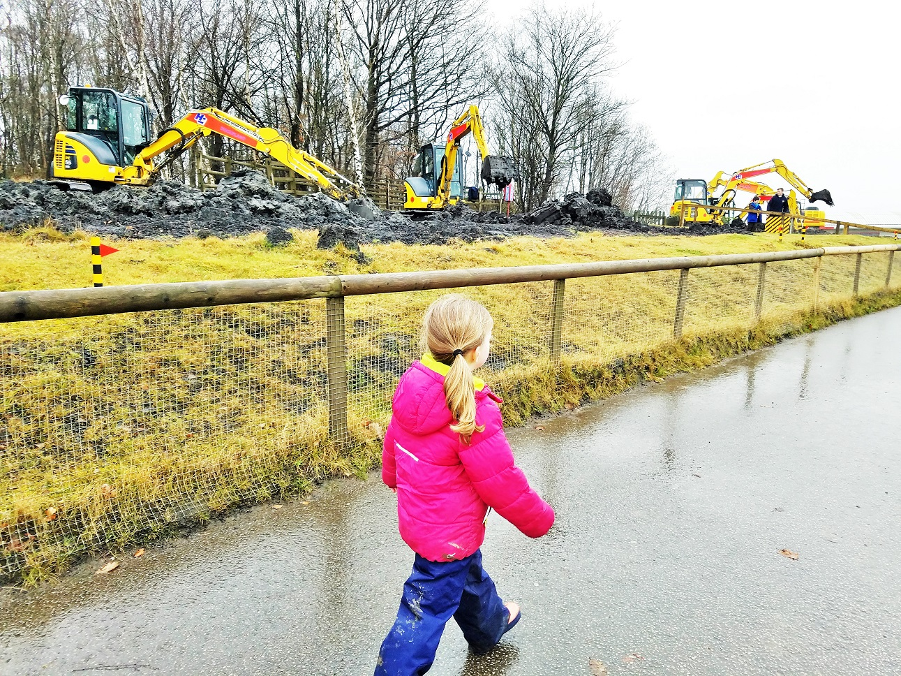 diggerland in the rain - child walking through diggerland