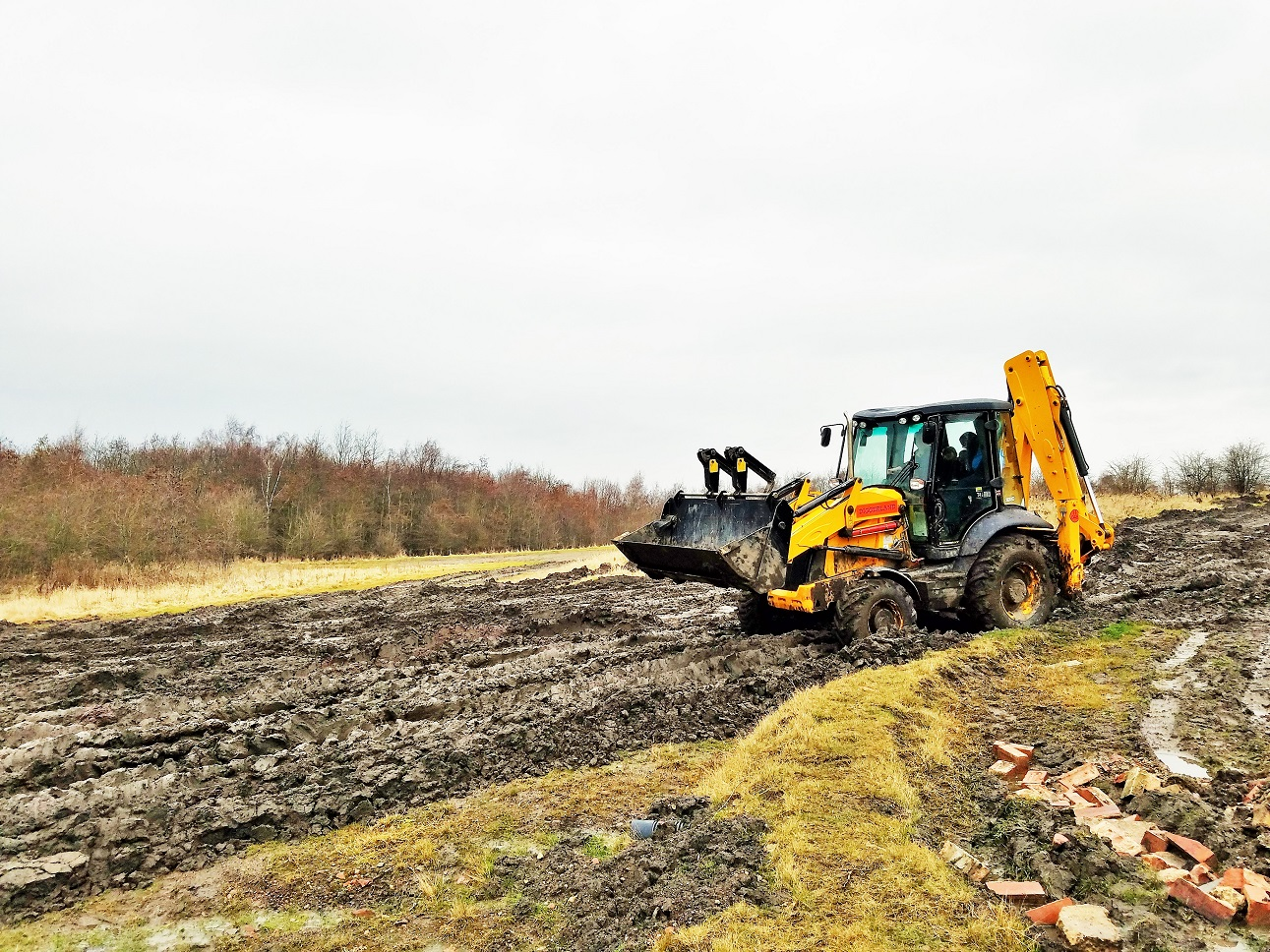Diggerland in the rain - large tractor driving through mud