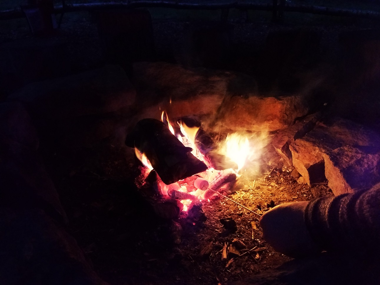 Toasting marshmallows on a campfire - family friendly glamping site North Star Club