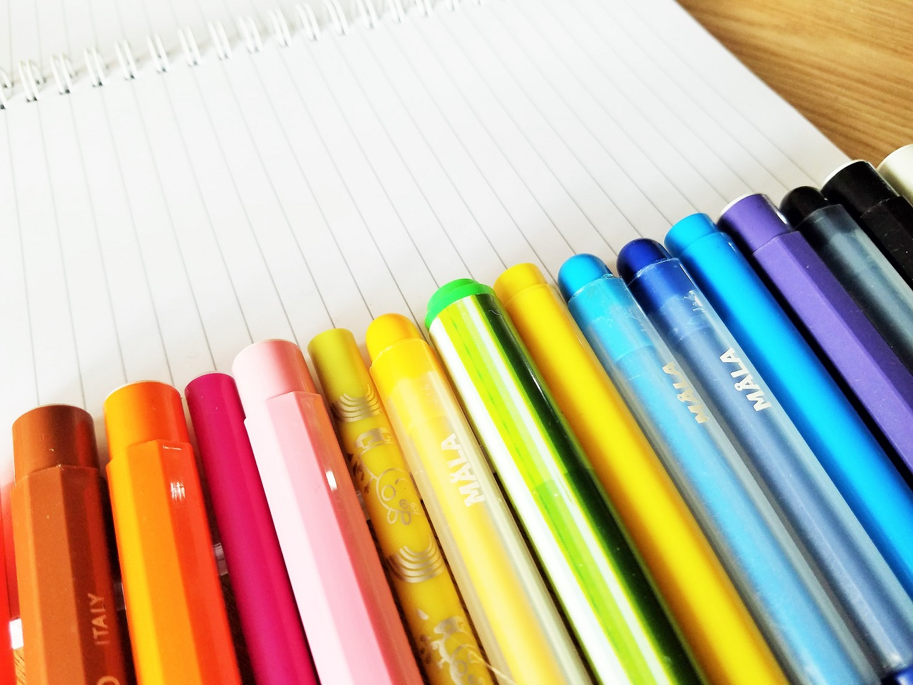 Spelling test - coloured felt tip pens on a lined notebook