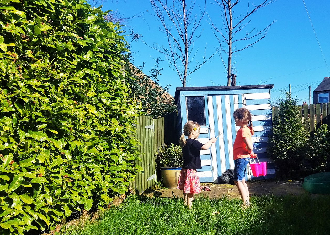 Future Teenage Kids - two children talking in the garden, sisters
