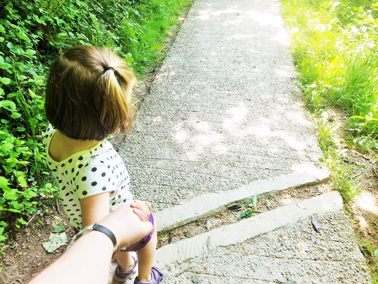 life as a mum blogger is like being in the royal family - mummy holding hands with little girl