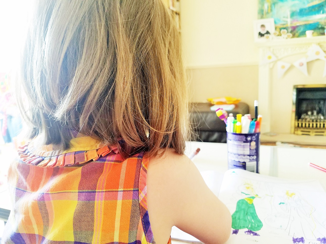 My big gamble and why mums can change the world - young child colouring in - blogcrush week 72