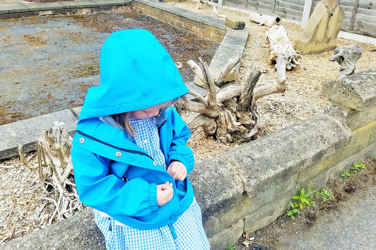 Gentle Parenting and the art of listening - how can I really listen to my child? - thoughtful child wearing blue coat