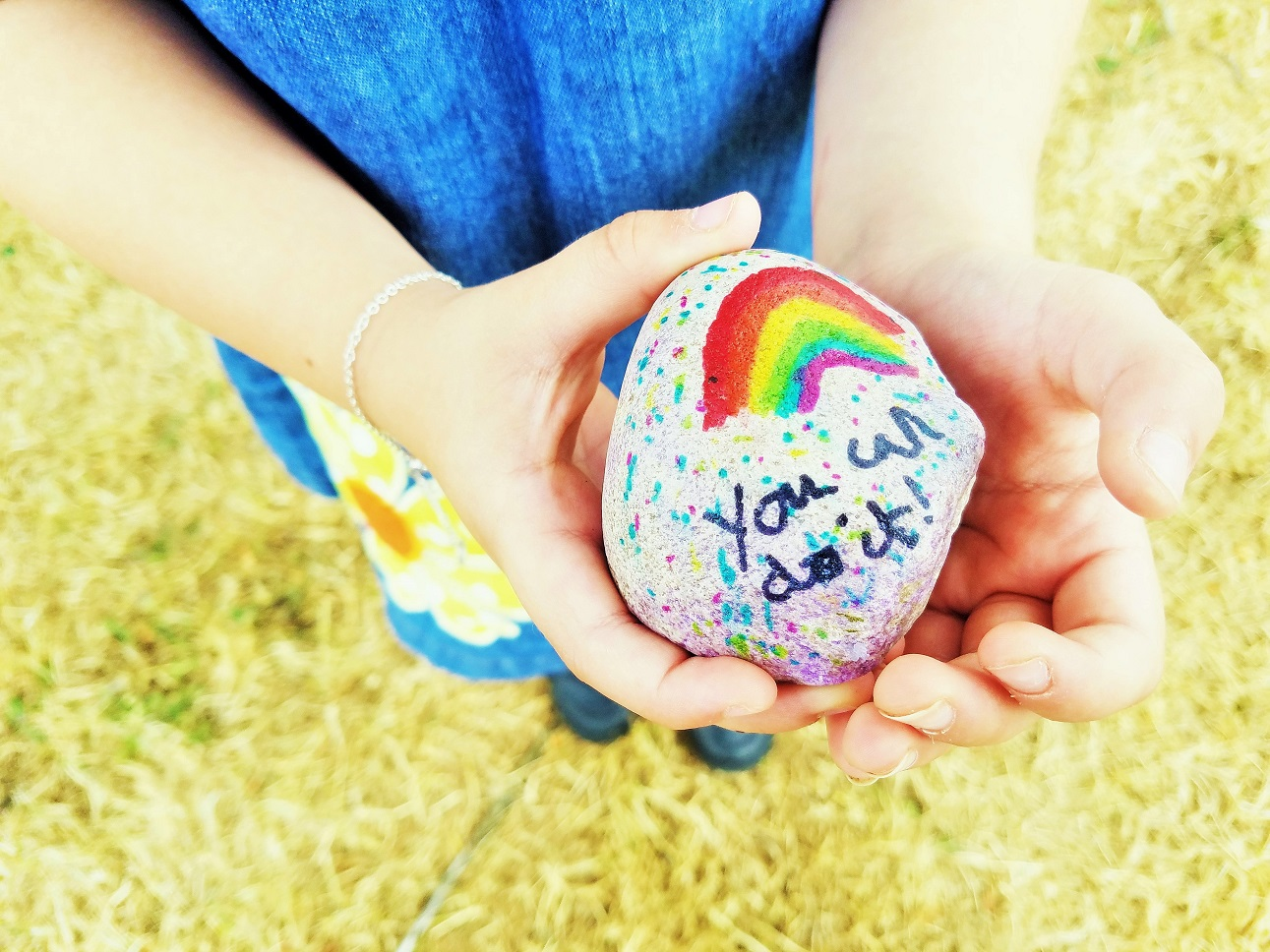 The End of Key Stage 1 and a Summer of Rest - child holding painted rock which says You Can Do It