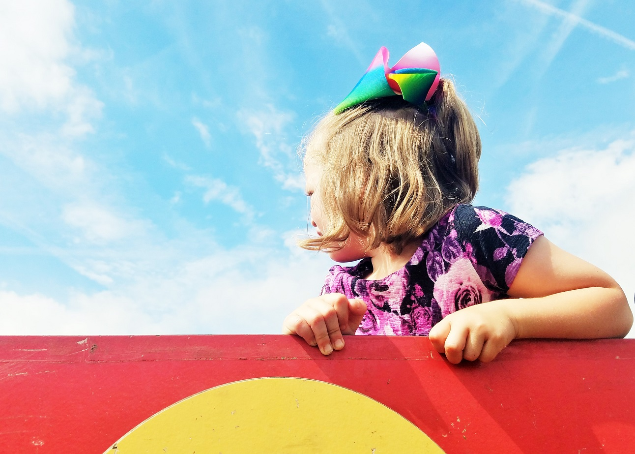 Why It's Essential To Add Empathy To Your Parenting Arsenal - child in a blue sky - BlogCrush Week 77