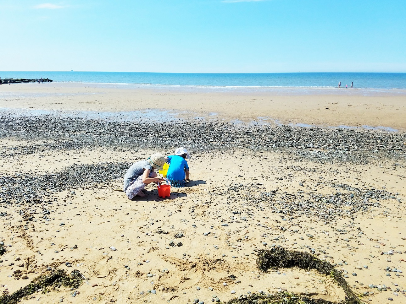 The kids are listening - is it okay to lie in front of your kids? - children collecting shells on the beach