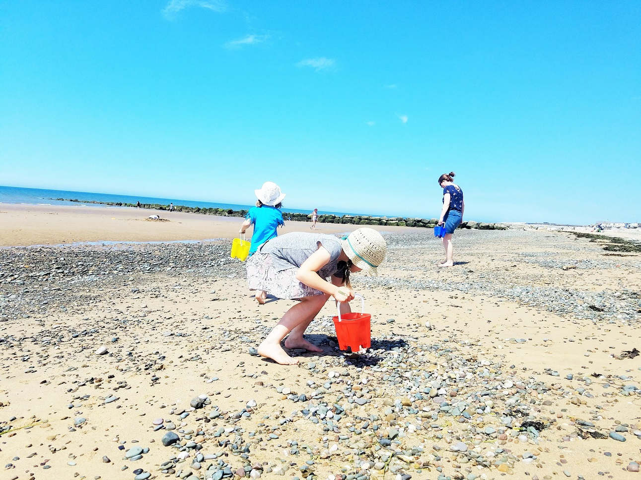 The kids are listening - why you should be careful what you say in front of your children - kids collecting shells on the beach