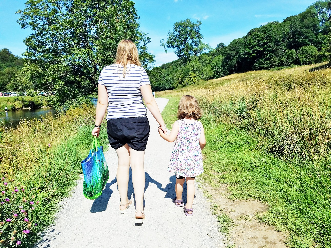 Positive attention as a gentle parenting technique - mum and child holding hands