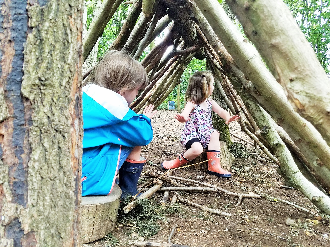 The problem with parenting advice - two children in a wigwam den of sticks