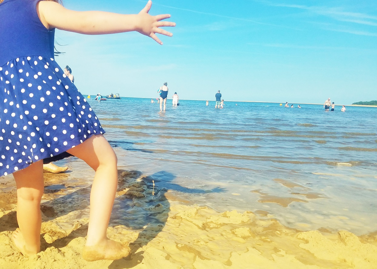 Gentle parenting is not airy fairy - child dancing at the edge of the sea