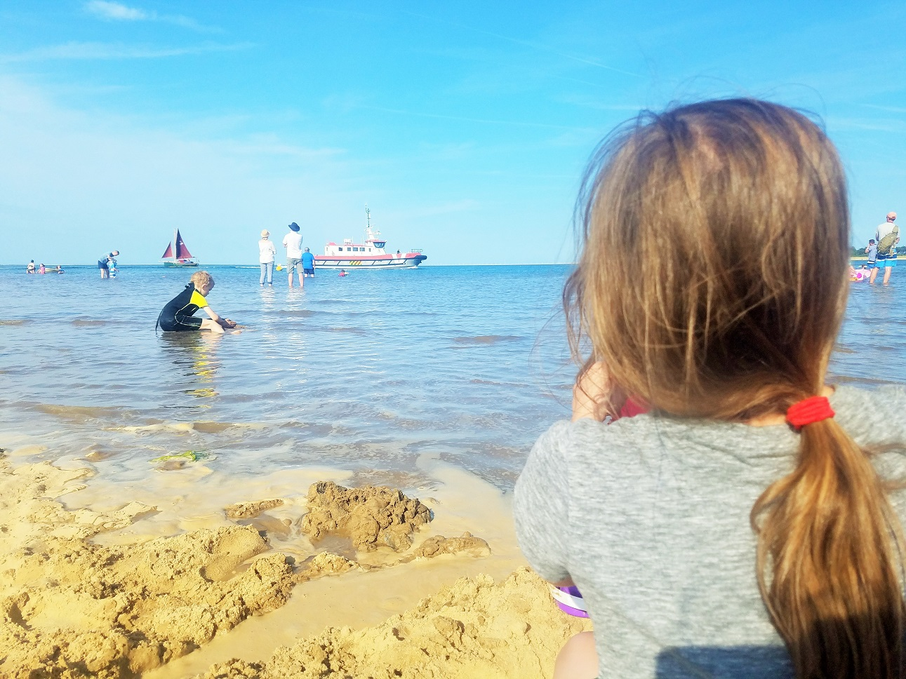 Gentle parenting is not lazy parenting - child watching a ship sail on the sea