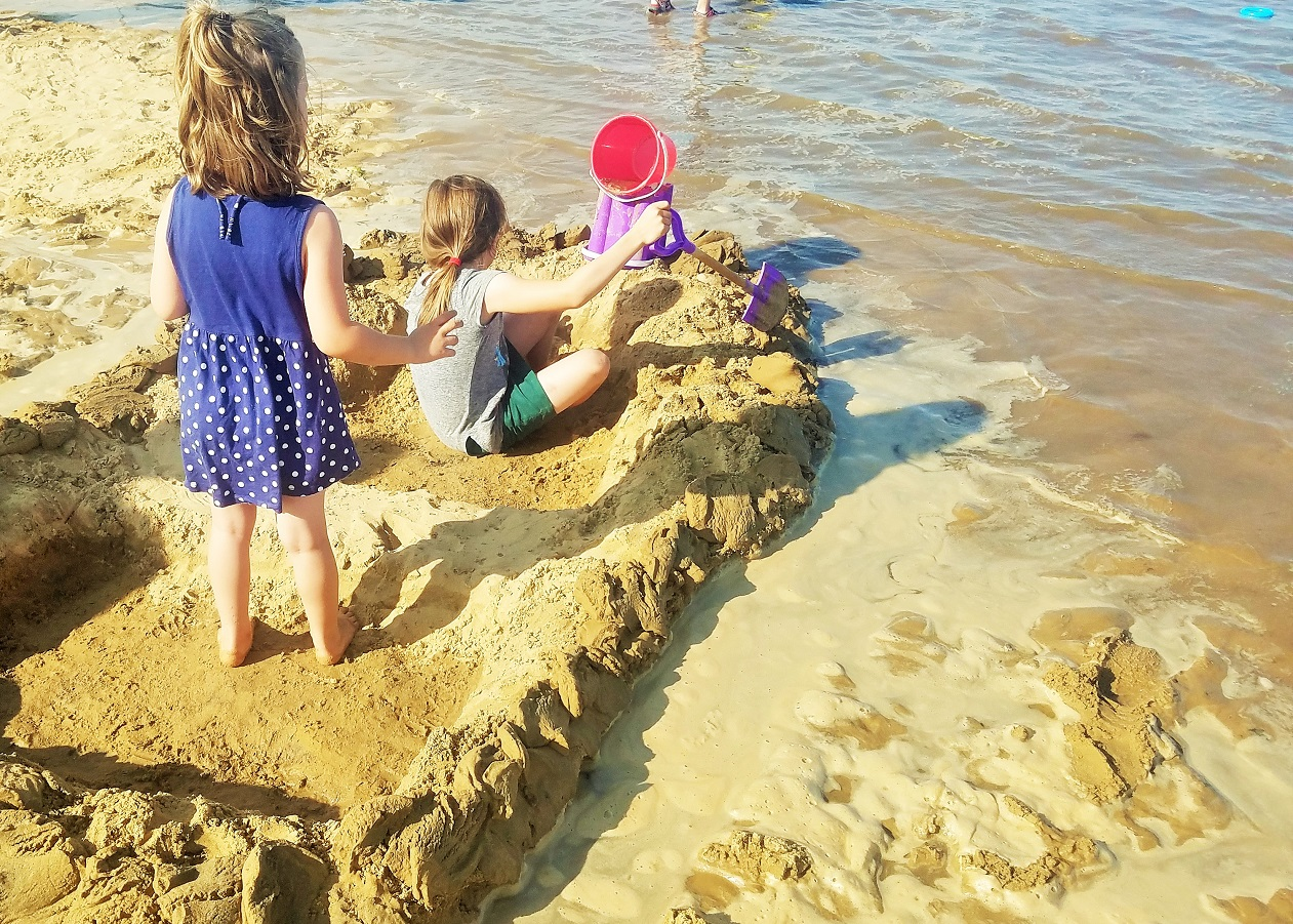 Gentle parenting misconceptions - gentle parenting is not ... - children making a boat out of sand