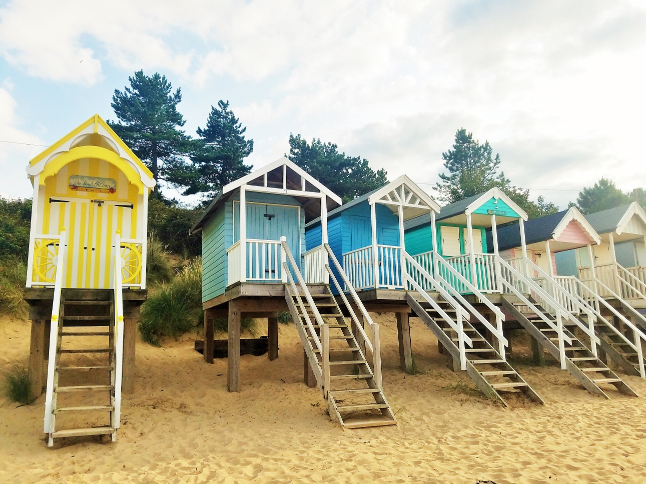 3 Things Gentle Parenting Is Not (& 3 things it is) - line of colourful beach huts at Wells-next-the-sea - BlogCrush Week 85