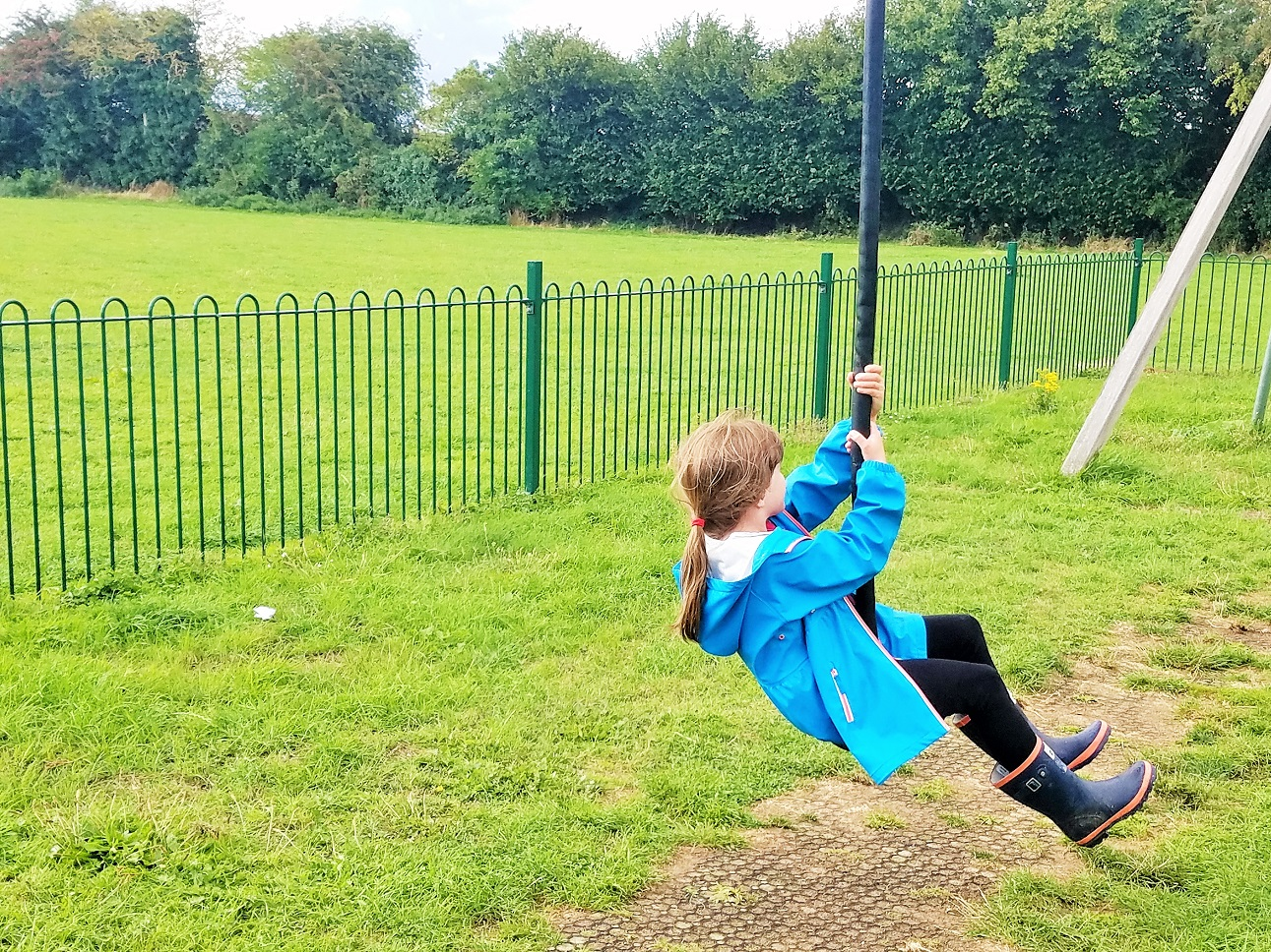 What does it mean to give positive attention to kids? Here are 37 ideas - child in blue coat on a zip wire