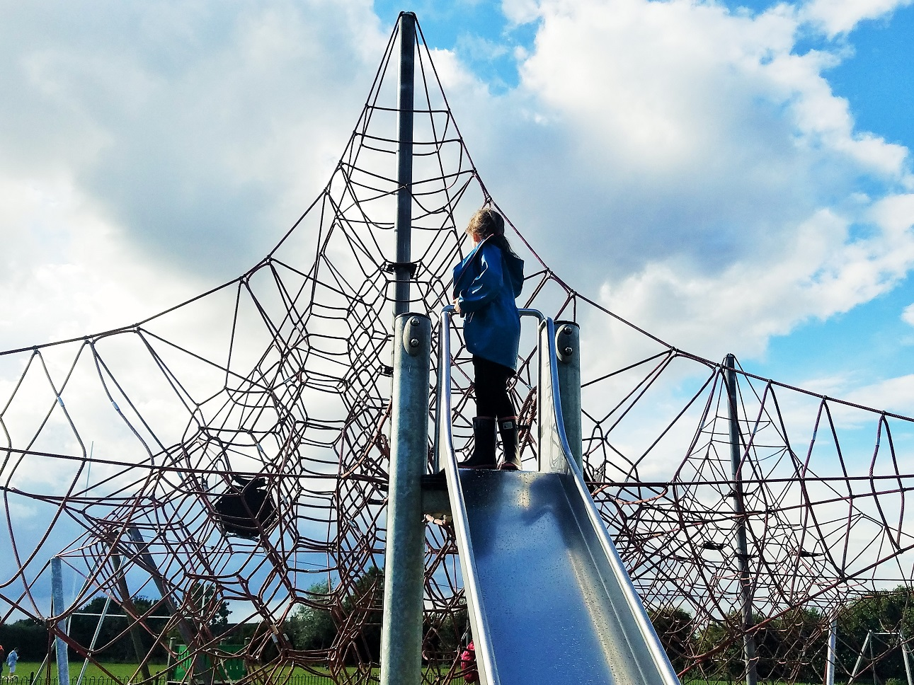 37 tiny ways to give positive attention to your children - child stood on top of a slide