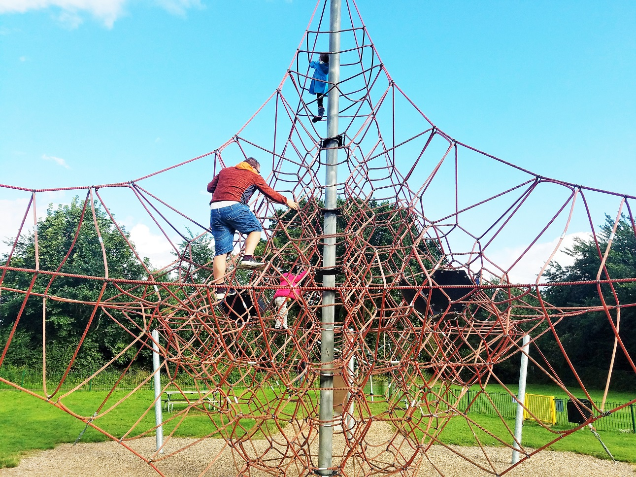 Easy ways for parents to give positive attention to their children - dad and kids on a climbing frame