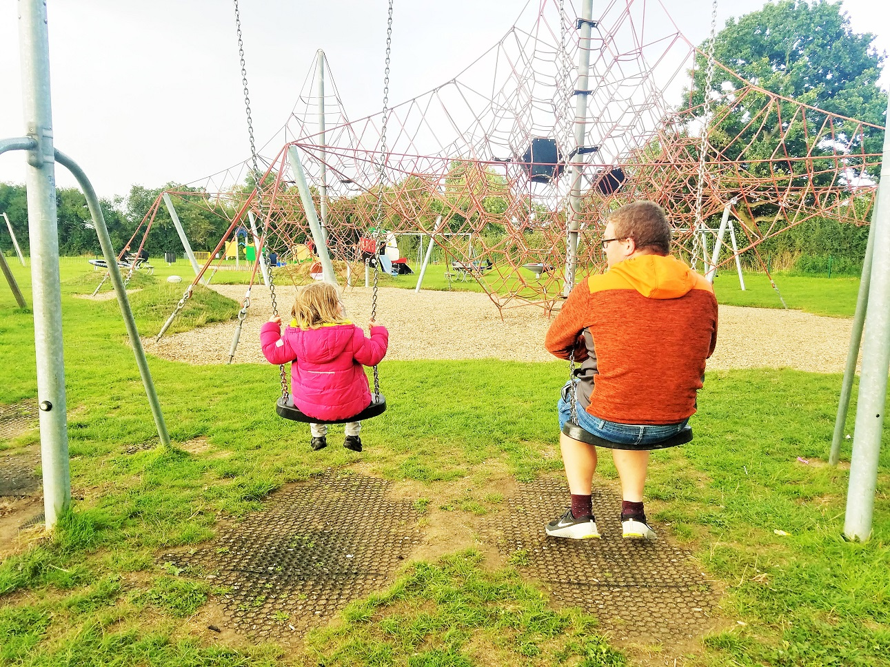 37 tiny ways to give positive attention to your kids - child talking to dad on the swings - BlogCrush Week 86