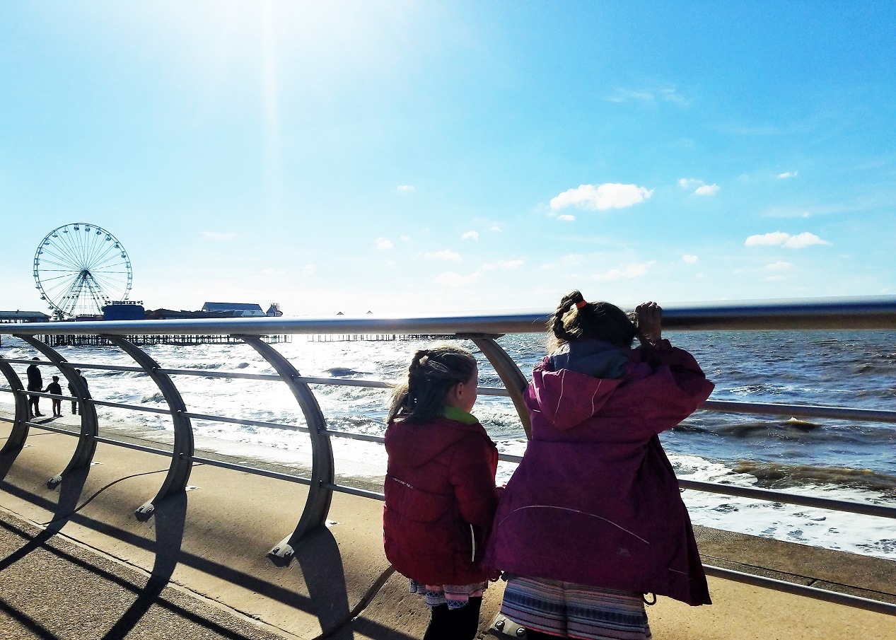 "How to get your kids to behave without resorting to ""we're going home"" - two children watching the sea"