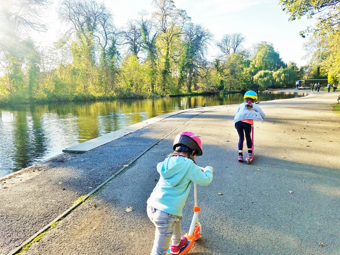 Hidden issues like a change in circumstances can cause bad behaviour in children - two children playing on scooters