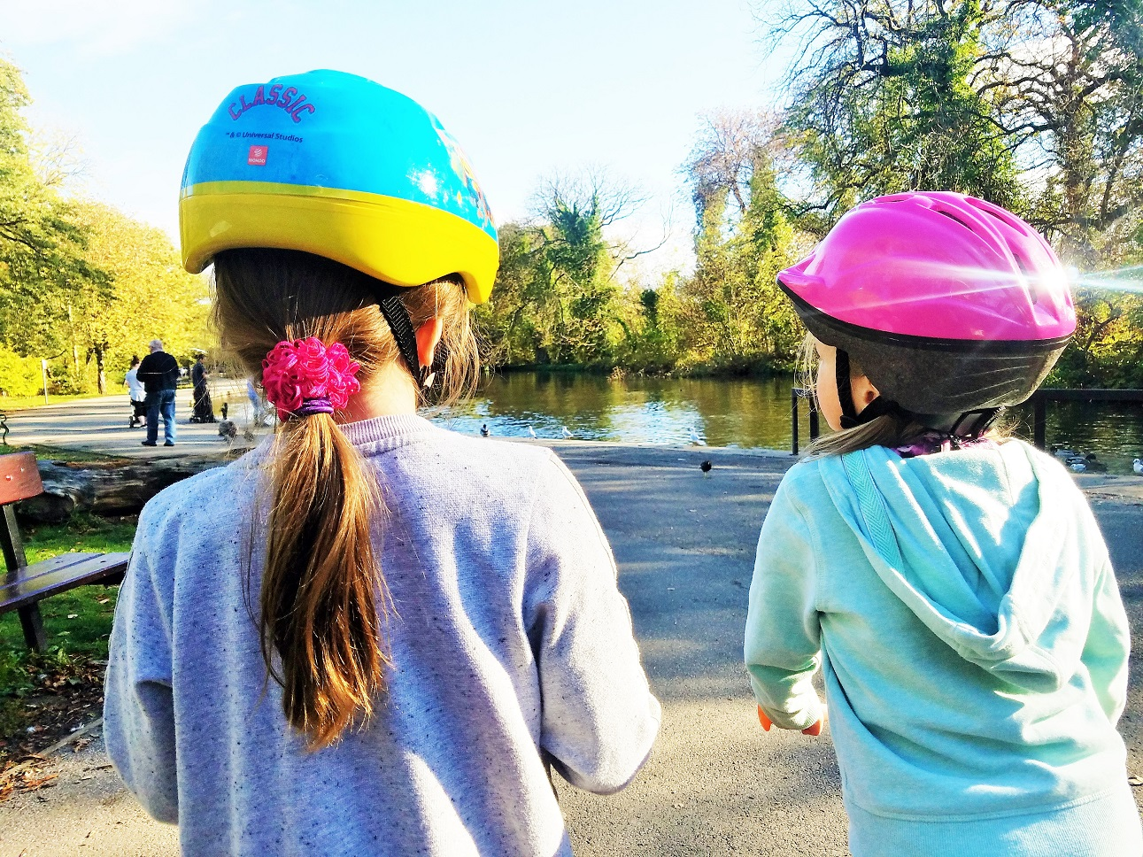 Hidden issues like sibling rivalry can cause behavioural issues - children in bike helmets