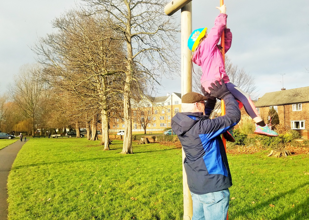 what to tell your interfering mother in law about gentle parenting - child climbing a firemans pole with help