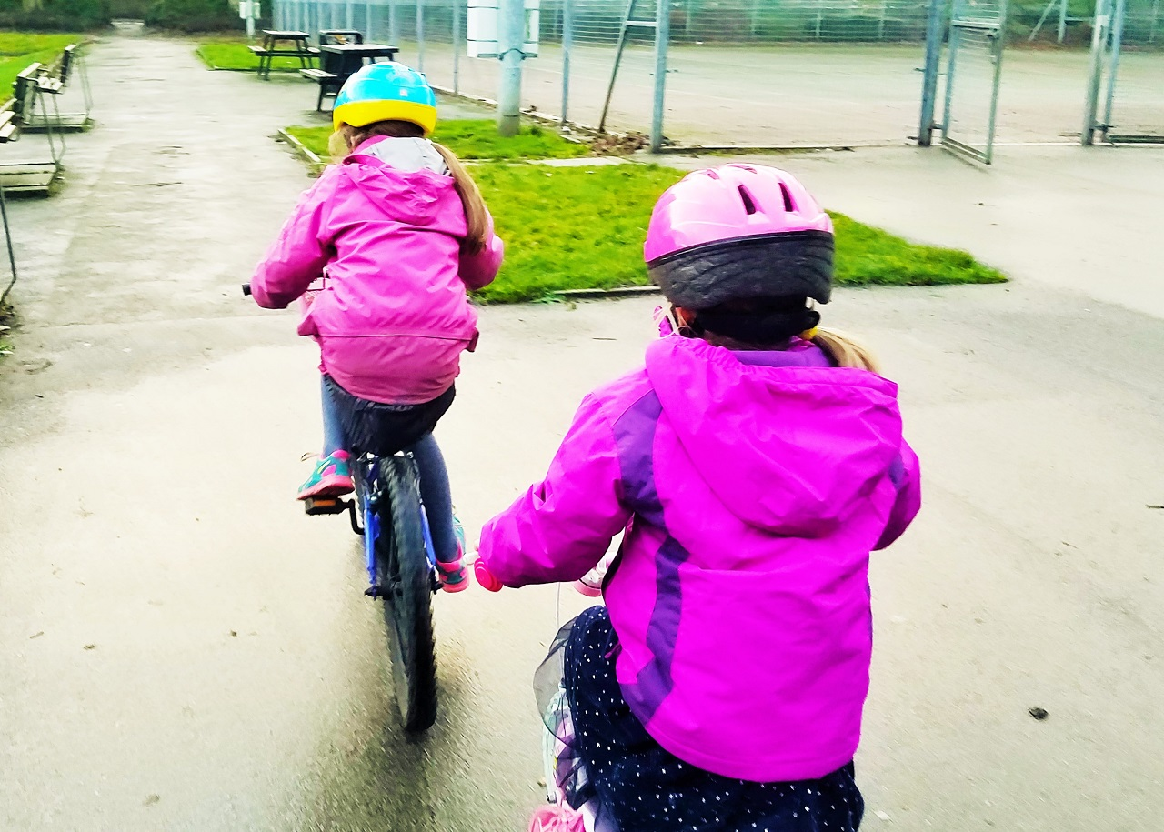 when you clash with your interfering mother in law over your parenting style - two girls riding bikes - blogcrush week 102