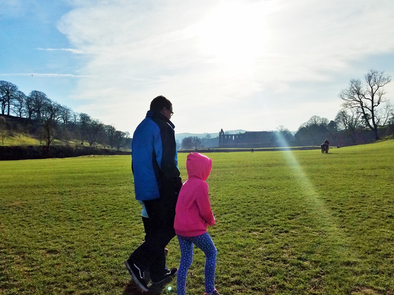 mental health can be boosted by gentle parenting girls walking with dad