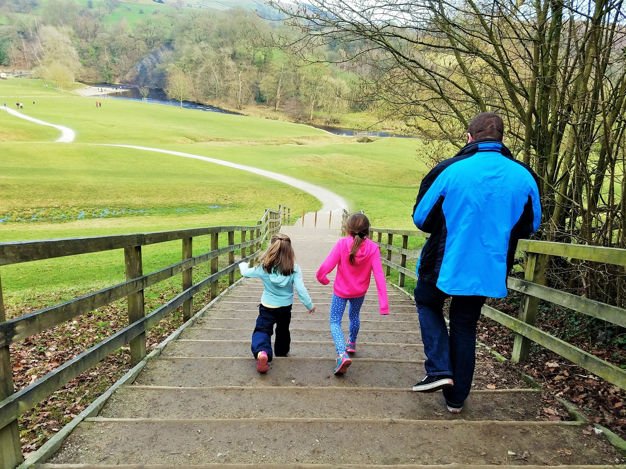 parenting myths passed down through the generations daughters and dad walking down steps