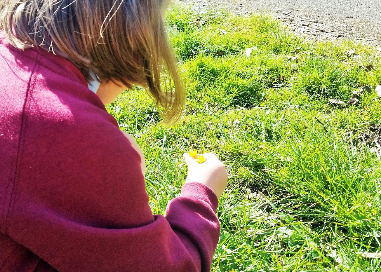 you can be a mum without shouting and here's how child picking flowers